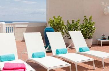 Pelican Grand Beach Resort oceanfront spa sun deck